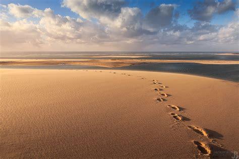 le crpuscule de la photo traces de pas sur la dune du pilat bassin d arcachon photographe tirages