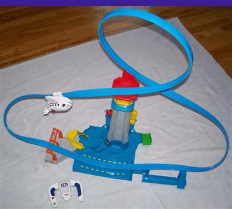 fisher price airplane swing fisher price geo trax air high flyin flying airport