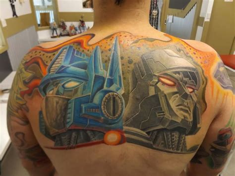 transformers tattoo in progress by simon sharp art