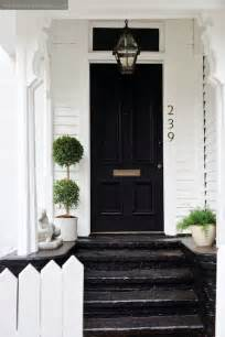 white house with black front door cottage home