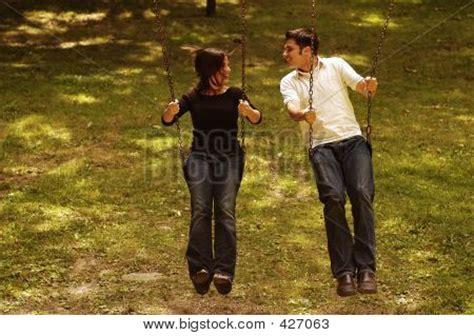 2 couples swing love couple swing park playground stock photo stock