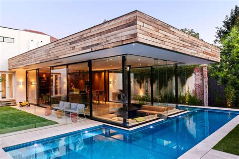 Modern Ranch Style by This House Has A Sunken Living Room So People Can Be At The Same Level As Those In The Swimming