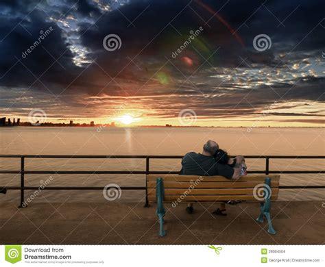 old couple on bench older couple on bench enjoying sunset stock images image