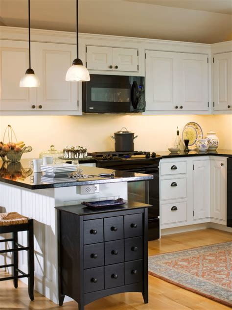 small kitchens with white cabinets and black appliances white cabinets and backsplash black counters and