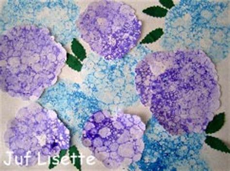bloemen in afwasmiddel en water fotograferen zomer