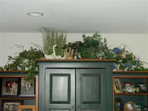 decorating top of tv armoire decorating above tv armoire joyful daisy