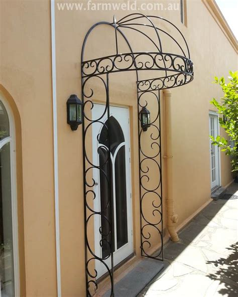 wrought iron awnings a wrought iron door canopy gives this otherwise plain wall