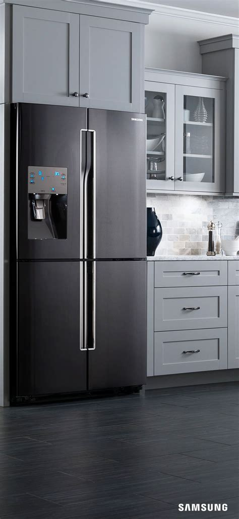 black kitchen cabinets with stainless steel appliances the next thing in kitchen inspiration is the samsung black