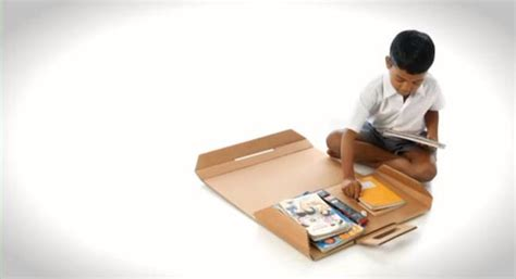 recycled cardboard help desk converts into bookbag for