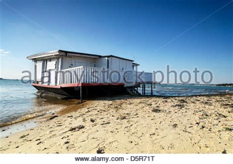 old house boats house boat on the beach at studland in poole harbour in dorset stock photo royalty