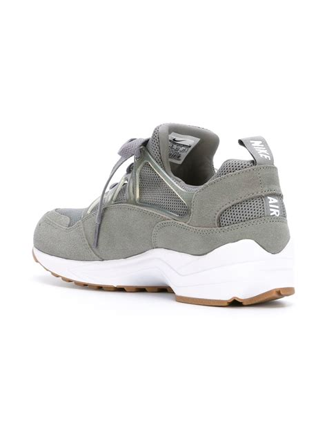 lighting sneakers nike air huarache light sneakers in gray for lyst