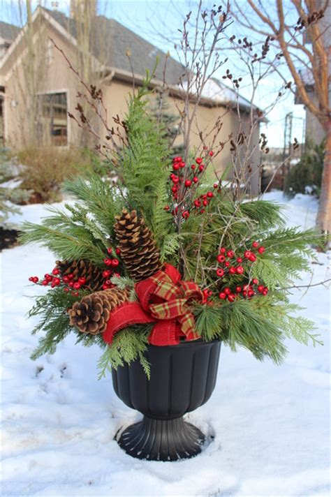 christmas decorating huge stone urns in front of entrance decor traditional landscape calgary by your space by design