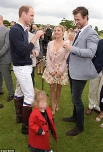 Chris hemsworth puts on loving display with elsa pataky at audi polo
