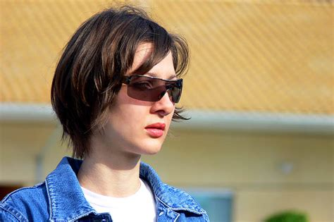 christine michael with short hair christine woman portrait jeans jacket glasses