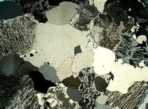 granite thin section quartz crystal in alkali granite cross polarized light