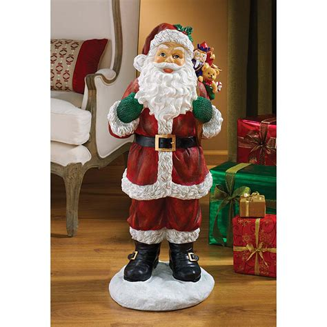 design toscano  visit  santa claus holiday statue