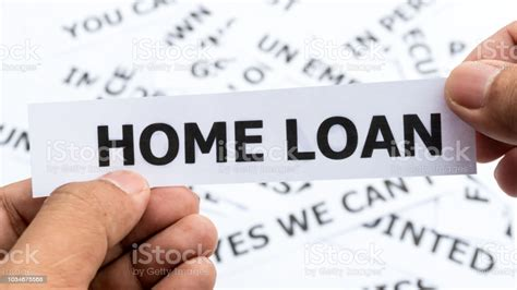 home loan text  word meaning  paper  hand holding
