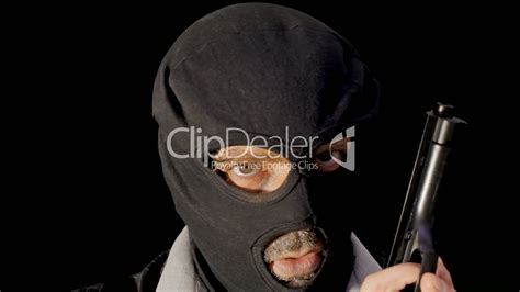 How Does A Felony Show Up On A Background Check Masked Criminal Showing Gun Up V 237 Deos De Archivo Y