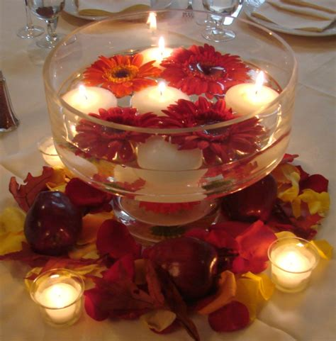 diy wedding centerpieces floating candles with red orange