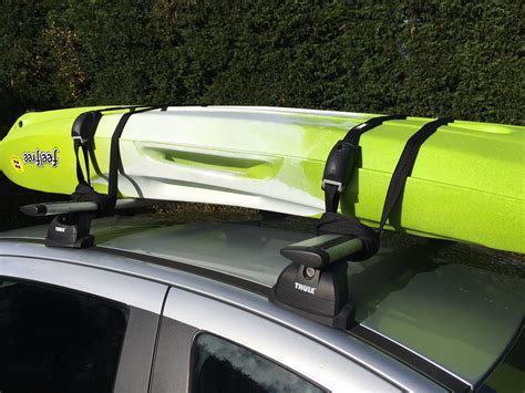 tie bar roof straps how to transport canoes kayaks an informative guide