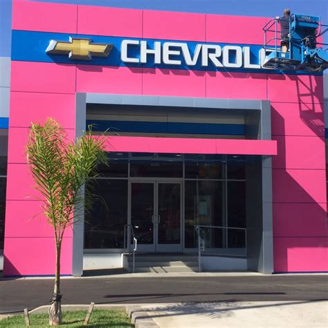 mission valley chevrolet building wrap in pink vinyl for dealership in mission