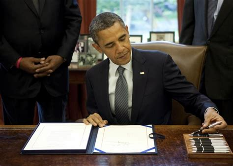 Obama Background Check Bill Obama Signs Bill Extending Interest Rate Relief For Student Loans