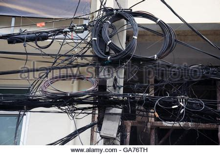 messy wires messy electrical cables on pole stock photo royalty free