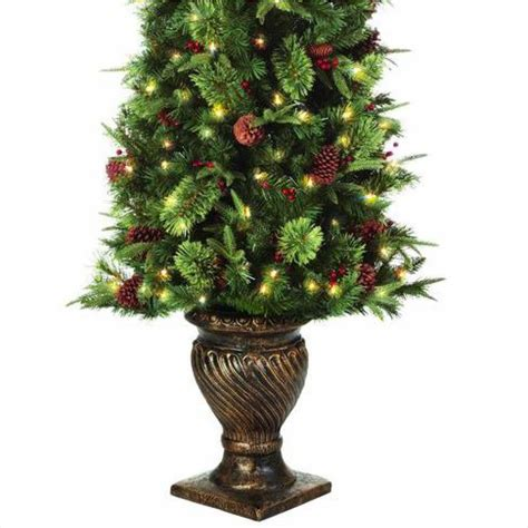 model ty78 797 200lr christmas tree home accents 6 5 ft pre lit potted artificial tree ty78 797 200lr the home