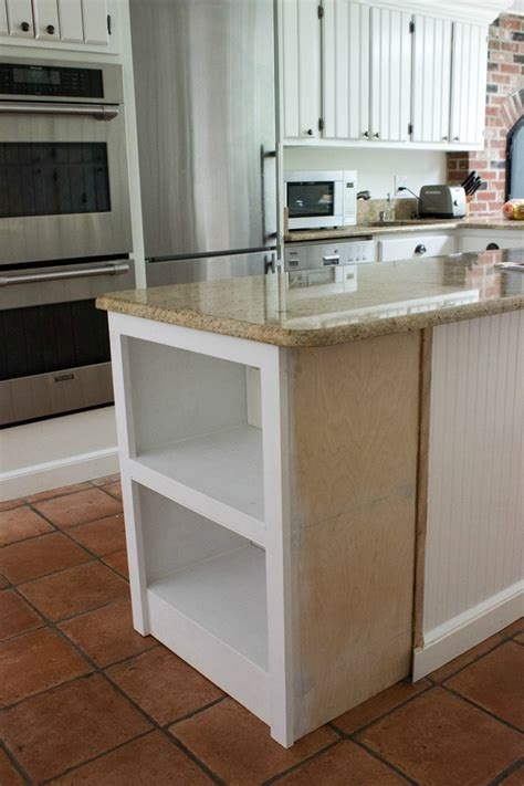 Adding A Kitchen Island | our remodeled kitchen island with built in microwave shelf