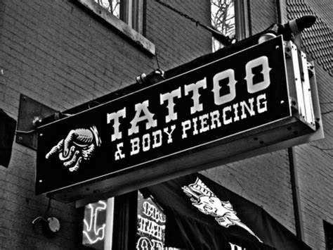 tattoo and body piercing shops black and white body piercing music piercing shop