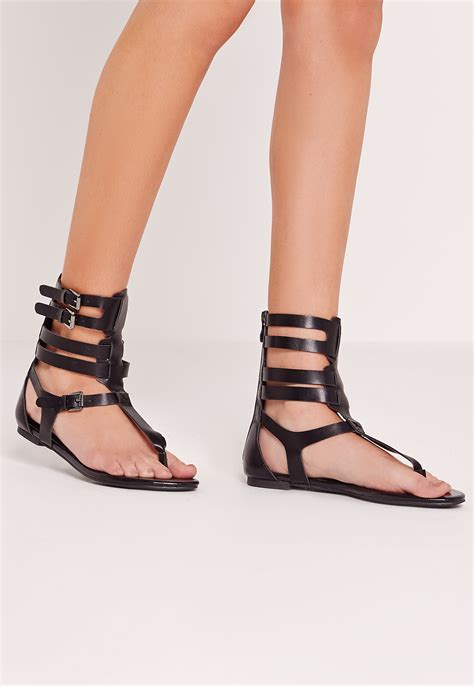 ankle gladiator sandals missguided strappy ankle flat gladiator sandals black in
