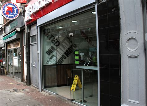 front curtain shutter shop front shutters gallery euro signs graphics ltd