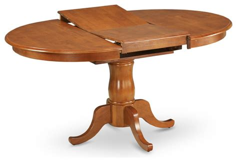 Oval Pedestal Dining Table With Leaf Portland Pedestal Oval Dining Table With Extension Butterfly Leaf Saddle Brown Traditional
