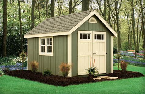 green backyard shed with almond trim i also the