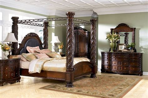 bed posts brown cherry hand carved post bed from ashley signature