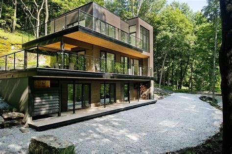 Modern House With Glass Walls by Elegance Modern House In Forest Design With Glass Wall