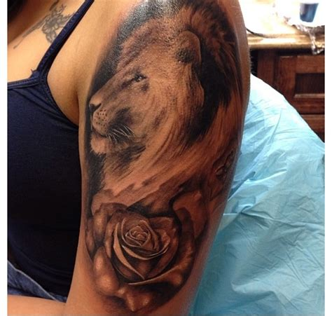 rose and lion tattoo with goodness