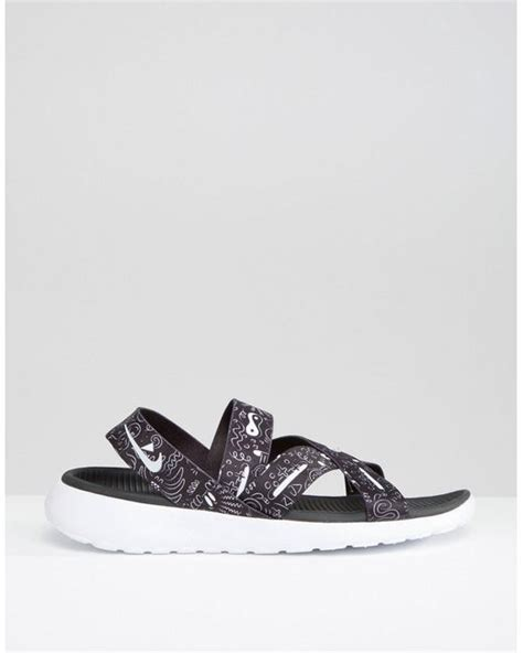 nike flat shoes womens nike black print roshe one flat sandals black in black