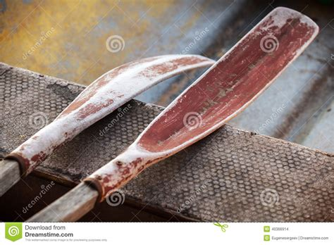 small boat oars old oars in small fishing boat stock photo image 40366914