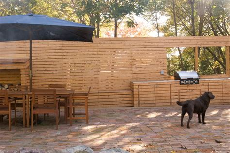 wood slat wall with outdoor kitchen
