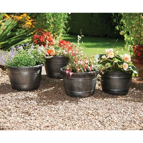 Barrel Planters Uk by Wood Effect Barrel Planters 4 All Gifts