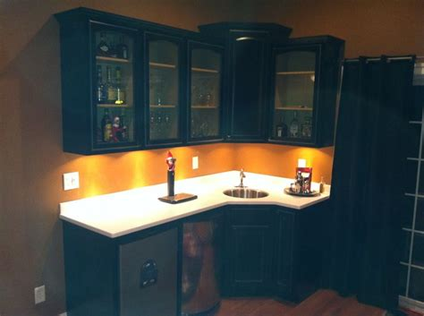 Armstrong Countertops by Armstrong Maple Cabinets With Staron Peak Solid Surface