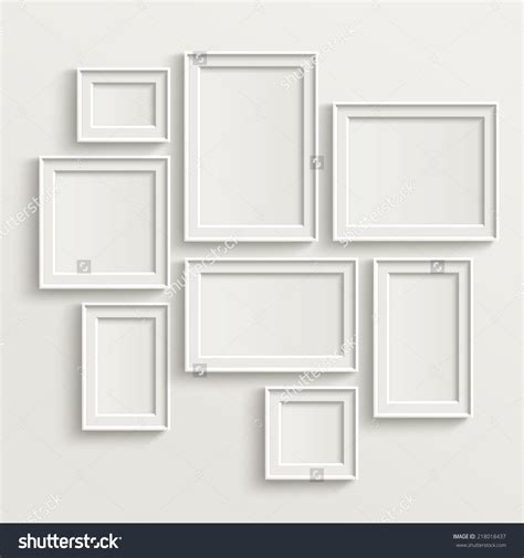 blank picture frame template set isolated on wall стоковая