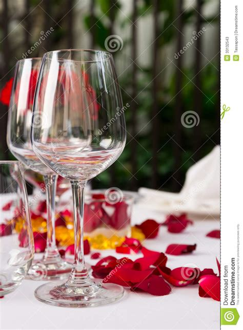 Wine Glass Table Decoration by Wine Glass Table Set With Petals Decorations Stock