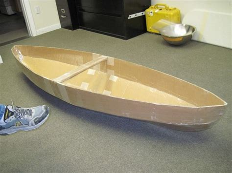 best cardboard boat design ever how to make a cardboard canoe for your kids in the pool 5