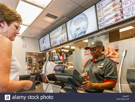 customer ordering fast food in a burger king restaurant stock photo royalty free image
