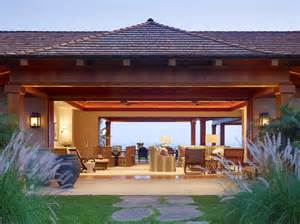 Indooroutdoor living exterior tropical remodeling ideas with stone