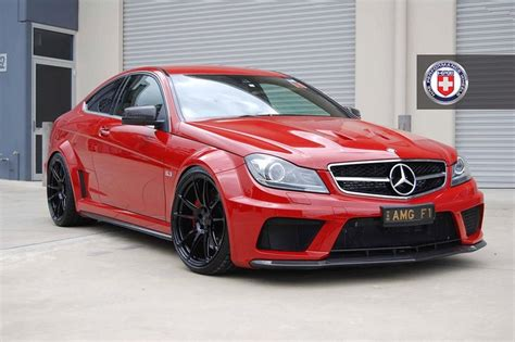 black and pink mercedes red mercedes c63 amg coupe black series sitting on hre