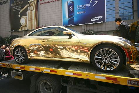 gold infiniti car peekture gold infiniti g37 in nanjing towed by traffic