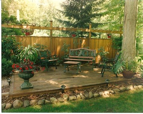 backyard platform deck platform deck woodchip and rock border fun things to do